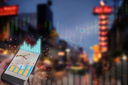 Economic recovery with financial technology or fintech on abstract bokeh night city on road at china town background. City life after corona virus COVID-19 pandemic concept and double exposure idea