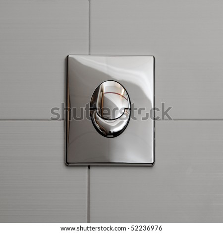 Economic toilet flush knob with two separate buttons. Grey tiles background