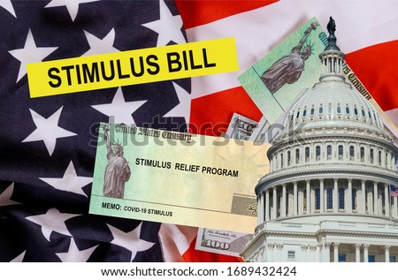 Economic U.S. STIMULUS RELIEF PROGRAM Bill Coronavirus Global pandemic Covid 19 financial lockdown from government US 100 dollar bills currency on American flag