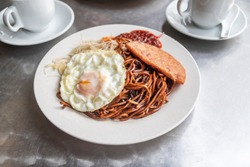 Economical Fried noodles with fried egg and luncheon meat
