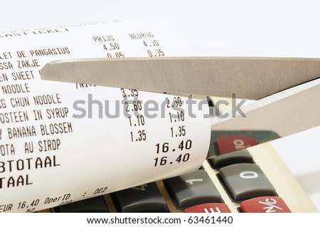 Economy concept with scissors cutting receipt from shop