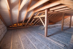 Ecowool insulation is poured in the attic. Eco-freandly clean