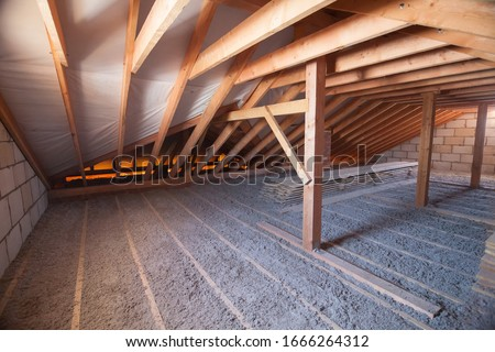 Ecowool insulation is poured in the attic. Eco-freandly clean Stock photo ©