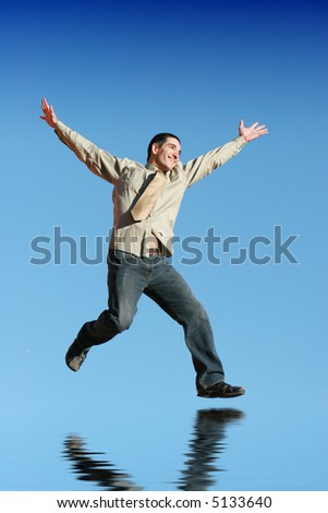 Ecstatic businessman jumping in the air