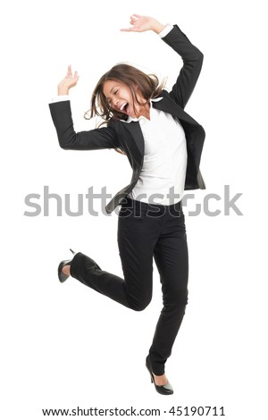 Ecstatic businesswoman in suit dancing. Excited happy asian business woman isolated in full length on white background. Mixed caucasian / chinese model.