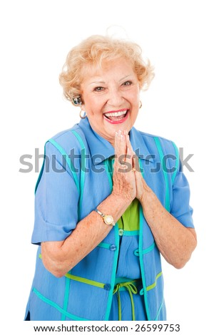 Ecstatic senior woman gets good news by phone, over her hands free set.  Isolated on white.