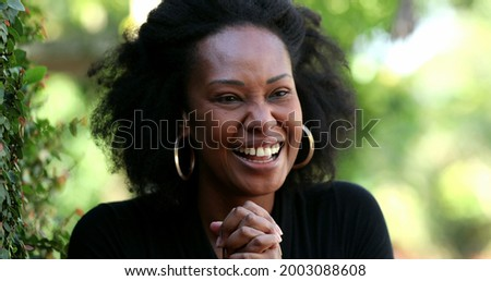 Ecstatic woman celebrating success and achievement, african black ethnicity Foto stock ©