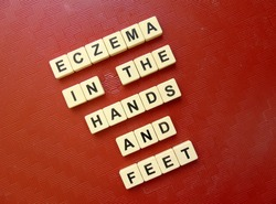 Eczema in the hands and feet, word cube with background.