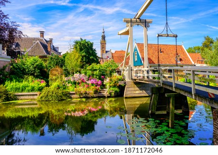 Edam town in North Holland, Netherlands, view of the historical wooden Kwakelbrug bridge and traditional houses in the Old town center