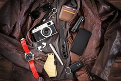 EDC or Every Day Carry items laid out on leather jacket