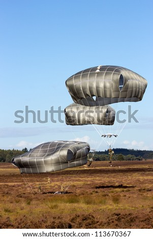 EDE, NETHERLANDS - SEP 22: Para troopers land on Dutch soil during the Operation Market Garden memorial on Sep 22, 2012 near Ede, Netherlands. Market Garden was a large Allied operation in 1944