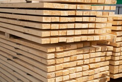 Edged boards in stock, ready for sale. Warehouse of construction materials.