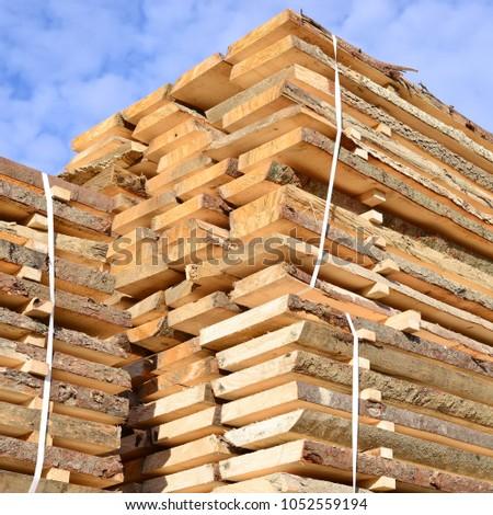 Edging board in stacks. #1052559194