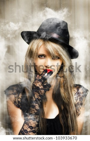 Edgy fifties portrait of smoking hot young beautiful sexy underworld gangster woman in retro lace outfit with glamorous make-up and hairstyle