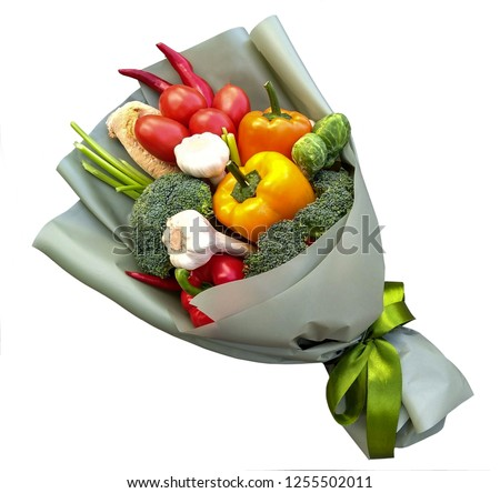 edible bouquet of vegetables for man, in green package with green ribbon, surprise, a snack made from red and yellow peppers, tomatoes, chili pepper, broccoli and Brussels sprouts and garlic. isolated