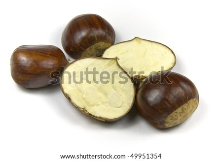 Edible chestnuts (castanea sativa) isolated on white