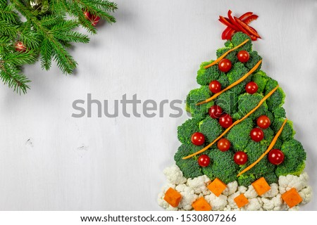 Edible Christmas tree shaped vegetable isolated on white background for holiday seasonal festive party celebration with healthy food decoration. Cooking step by step