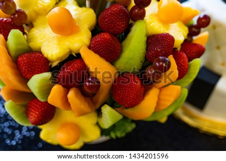 Edible Fruit basket arrangement with a variety of fruits #1434201596