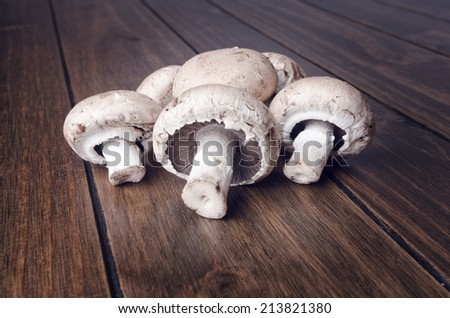 Shutterstock Edible mushrooms on wood table, raw food.