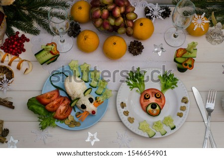 Edible rat and edible deer made of vegetables for the festive New Year and Christmas table. Idea for decorating holiday dishes. How nice to serve vegetables and salad. Children's menu.