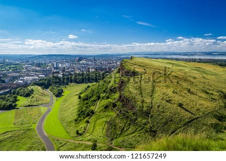 Edinburgh and green hills in summer - stock photo