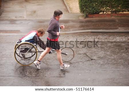 EDINBURGH - APRIL 18: A disabled athlete takes part in the Edinburgh Chris Hoy Half Marathon, here going down Lochend Road, on April 18th, 2010 in Edinburgh, UK.
