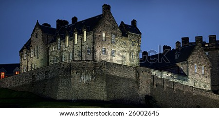 Edinburgh Castle, illuminated at nightfall, in winter from the north west.