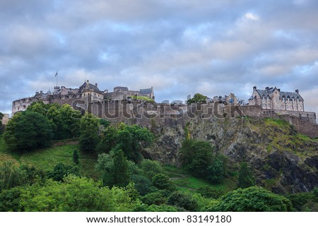 edinburgh castle, main tourist attraction of the capital of scotland, at sunrise with beautiful sky filled with clouds