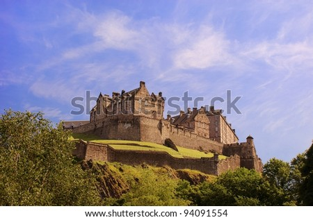 Edinburgh Castle on a warm sunny day, viewed from Princes Street Gardens.