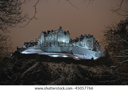 Edinburgh Castle, Scotland, UK, illuminated at night in the winter snow