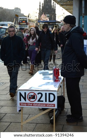 EDINBURGH - DECEMBER 17: a man offers passers by to sign a petition against ID cards on December 17, 2011 in Edinburgh, UK. ID cards could be issued to all UK citizens in the coming years.