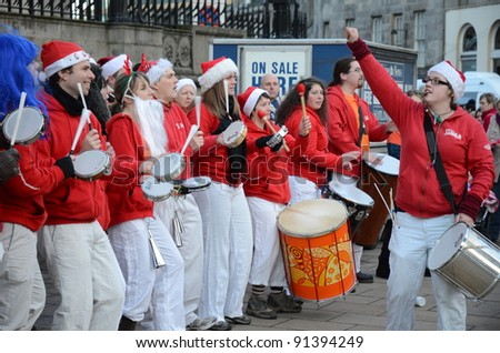 EDINBURGH - DECEMBER 17: musicians dressed as Santa play on December 17, 2011 in Edinburgh, UK. Princes Street attracts novelty acts over the Christmas period to raise money for charities.