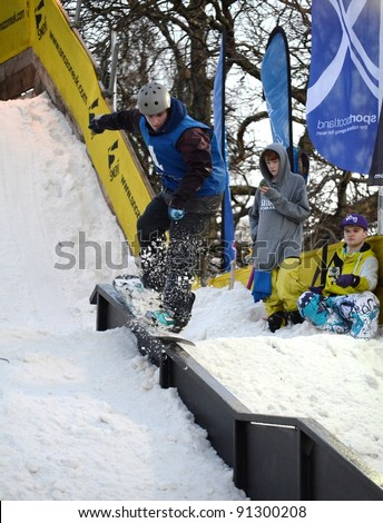 EDINBURGH - DECEMBER 17: unidentified competitors take part in the Scottish Snowsports Festival on December 17, 2011 in Princes Street Gardens, Edinburgh, UK.