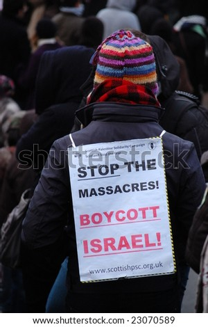 EDINBURGH - JANUARY 10: A woman wears an anti-Israel placard at the anti-Israel rally in Princes Street Gardens January 10th, 2009 in Edinburgh, Scotland.