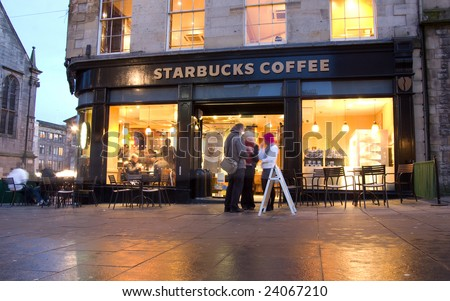 EDINBURGH - JANUARY 28: Starbucks announced it will cut around 6,700 jobs and shut 300 stores on January 28th, 2009. This Starbucks coffee shop is in Edinburgh, Scotland.