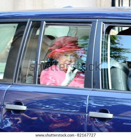 EDINBURGH - JULY 2: Queen Elizabeth II exits Holyrood Palace in the back of a motor vehicle on her way to present Colours to troops in Holyrood Park on July 2, 2011 in Edinburgh, Scotland.