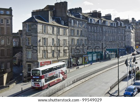 EDINBURGH - MARCH 31: A bus passes tenements at the south end of Leith Street in the New Town on March 31, 2012 in Edinburgh, Scotland. Edinburgh's New Town is a UNESCO World Heritage Site.