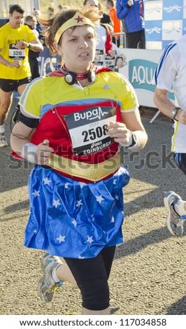 EDINBURGH - OCTOBER 7: An unidentified  runner participates in the Bupa Great Edinburgh Run 10k on October 7, 2012 in Edinburgh, Scotland.