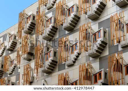 "EDINBURGH, SCOTLAND - APRIL 27, 2016: The MSP's building of the Scottish Parliament in Holyrood Park, Edinburgh.  This building has distinctive bay windows with concrete ""bamboo"" poles."