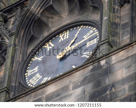 Edinburgh, Scotland - September 26 2018: University of Edinburgh, School of Divinity  (clock detail) #1207211155