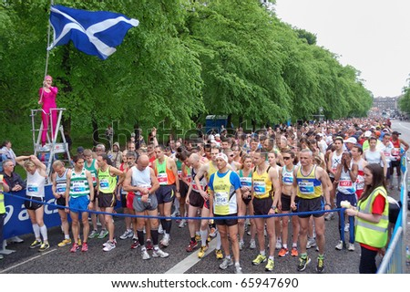 EDINBURGH, SCOTLAND, UK - MAY 23: Group of runners starts  the Edinburgh Marathon , May 23, 2010 in Edinburgh, UK