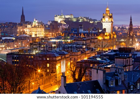 Edinburgh Skylines building and castle from Calton Hill at dusk Scotland UK