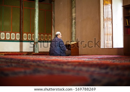 EDIRNE- DECEMBER 28 Muslim man studying the quran in the mosque at Thrace region on December 28 2013 in Edirne Turkey