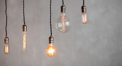 Edison lamp is included in loft room, against background of concrete wall.