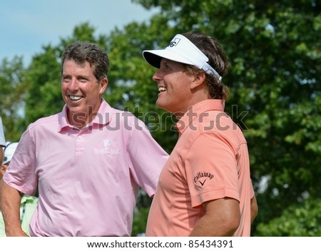 EDISON,NJ-AUGUST 24: Barclays CEO Robert Diamond (L) with golfer Phil Mickelson during the Barclays pro-am held at the Plainfield Country Club on August 24,2011 in Edison,NJ.
