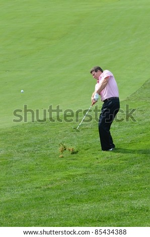 EDISON,NJ-AUGUST 24: Barclays CEO Robert Diamond takes a shot from the rough during the Barclays pro-am held at the Plainfield Country Club on August 24,2011 in Edison,NJ. - stock photo