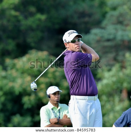 EDISON,NJ-AUGUST 23: Golfer Brian Davis watches his shot during the Barclays practice round held at the Plainfield Country Club on August 23,2011 in Edison,NJ.