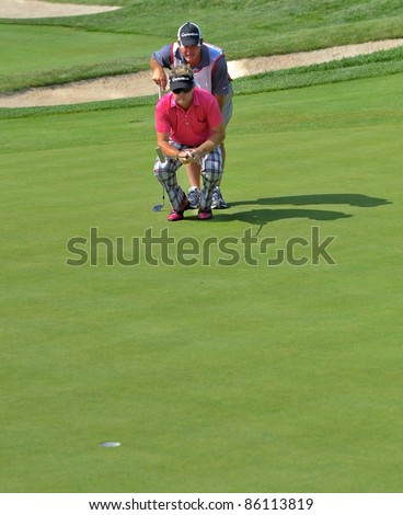 EDISON,NJ-AUGUST 26: Golfer Brian Gay (front) and his caddy look at the green during the second round of the Barclays Tournament held at the Plainfield Country Club on August 26,2011 in Edison,NJ