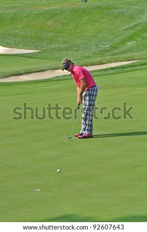 EDISON,NJ-AUGUST 26:Golfer Brian Gay watches his putt during the second round of the Barclays Tournament held at the Plainfield Country Club on August 26,2011 in Edison,N.J.
