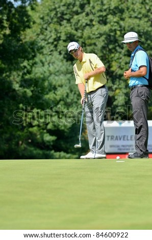 EDISON,NJ-AUGUST 23: Golfer David Hearn putts during the Barclays practice round held at the Plainfield Country Club on August 23,2011 in Edison,NJ.